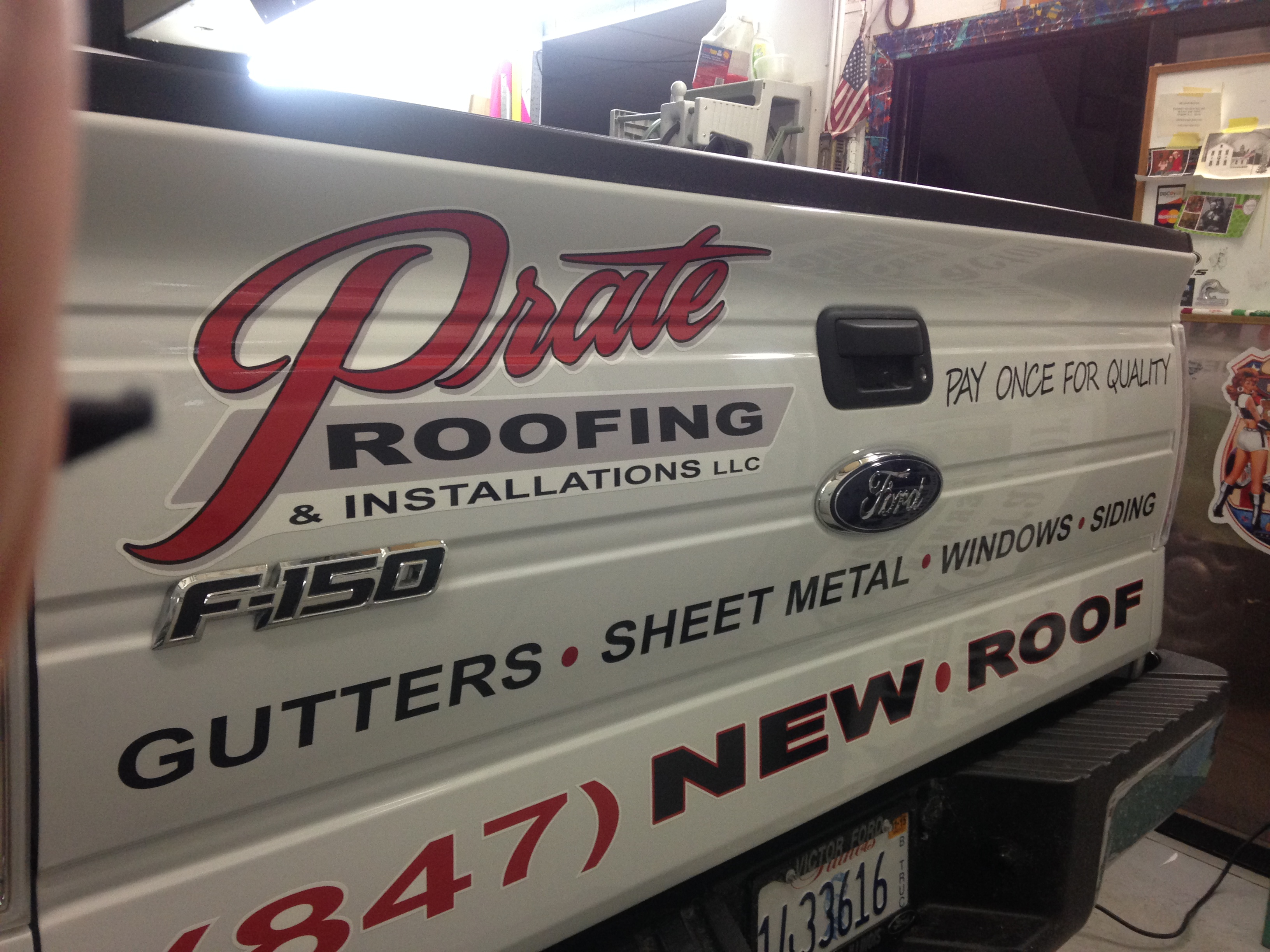 Prate Roofing White Pickup Truck Tailgate